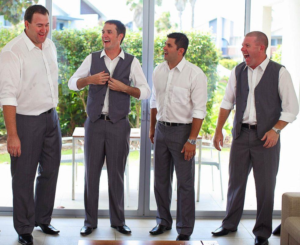 groomsmen laughing, wedding fun
